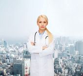 healthcare and medicine concept - serious female doctor with stethoscope