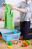 Busy Father Cleaning And Doing Laundry