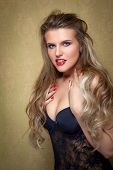 pic of libido  - Portrait of young beautiful girl with long hair near the wall in the corner - JPG