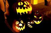 Halloween Pumpkins At Night In Front Of The Door
