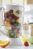 Blender filled with fresh fruits, close-up