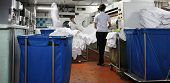 stock photo of laundry  - photograph of laundry in slow motion with people working on - JPG