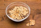 Cereals in bowl on wood
