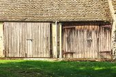 picture of barn house  - The old wooden barn with two doors in the english rural countryside - JPG