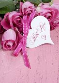 Pink Roses On Pink Wood Background Closeup With Happy Valentines Day Heart Shape Gift Tag, Vertical