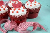 stock photo of red velvet cake  - Happy Valentine red velvet cupcakes with love messages on green teal blue sixties style vintage wood background - JPG
