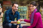 image of department store  - Beautiful Young Couple Shopping For Fruits And Vegetables In Produce Department Of A Grocery Store  - JPG