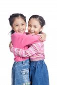 Asian Twin Sisters Hug Each Other With Love