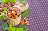 stock photo of cobnuts  - hazelnuts on plate and on a table - JPG