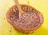 picture of flax seed oil  - flax seed in basket and on a table - JPG