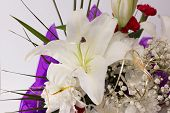 stock photo of easter lily  - flowers of a white lily and other flowers in a big beautiful bouquet - JPG