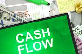 Tablet with words Cash flow