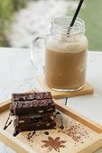 Delicious Chocolate Brownies On Wooden Plate