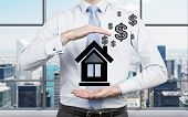 Businessman Holding Drawing House