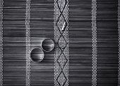 Two wedding rings on bamboo mat