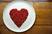 pic of dessert plate  - A heart made of goji berries on a plate - JPG