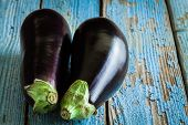 picture of wooden basket  - Two raw organic eggplant on old rustic wooden background - JPG