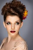 Beautiful woman with flowers. Perfect face skin. Beauty Portrait. Fashion photo. Fashion make up.