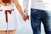 pic of walking away  - Happy couple in love holding hands walking away near the sea - JPG