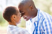 intimate african american couple flirting outdoors