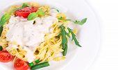 Italian pasta with pesto and herbs.