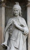 ZAGREB, CROATIA - SEP 25: statue of Saint Florian on the portal of the cathedral dedicated to the Assumption of Mary and to kings Saint Stephen and Saint Ladislaus in Zagreb on Sep 25, 2013.
