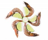 Raw shrimps on plate with lime.