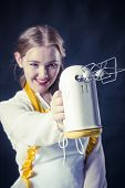 image of mixer  - Photo of young smiling housewife with mixer - JPG