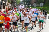 Cracovia Marathon. Runners on the city streets on May 18 2014 in Krakow POLAND
