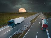Trucks On Highway At Night Of The Full Moon