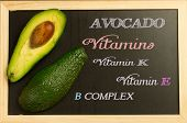 image of avocado  - avocado on a blackboard with the inscription of vitamins that avocado contains - JPG