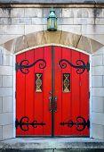 Ornate Red Door Set In Limestone