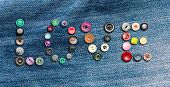 Many colorful buttons forming the word 'love'