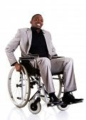 Optimistic disabled african american businessman sitting on wheelchair