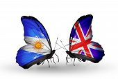 Two butterflies with flags on wings as symbol of relations Argentina and UK