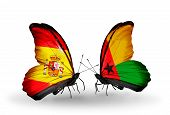 Two Butterflies With Flags On Wings As Symbol Of Relations Spain And Guinea Bissau