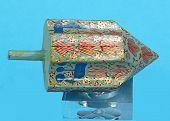 stock photo of dreidel  - Closeup of a Chanukah dreidel on a blue background - JPG