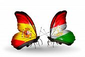 Two Butterflies With Flags On Wings As Symbol Of Relations Spain And Tajikistan