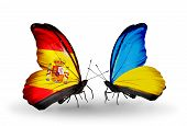 picture of spanish money  - Two butterflies with flags on wings as symbol of relations Spain and Ukraine - JPG
