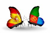 stock photo of eritrea  - Two butterflies with flags on wings as symbol of relations Spain and Eritrea - JPG
