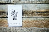 Old Paper Sketch Book With Hand-drown Heart Shaped Dlower Over Vintage Wooden Background