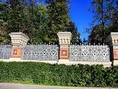 foto of old stone fence  - Column old fence with paintings in the old Russian style - JPG