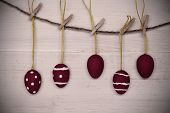 Five Red Easter Eggs Hanging On Line With Frame