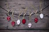 Many Red And White Easter Eggs Hanging On Line  With Frame