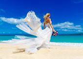 Beautiful Blond Fiancee In White Wedding Dress With Big Long White Train And With Wedding Bouquet