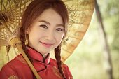 picture of traditional dress  - Chinese girl with dress traditional Cheongsam in Garden - JPG