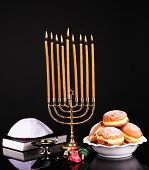 Festive composition for Hanukkah isolated on black