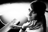 stock photo of helpdesk  - Woman sitting at helpdesk with keyboard closeup photo - JPG