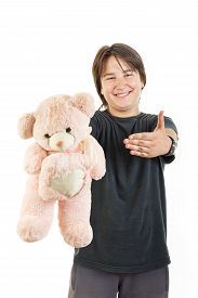 stock photo of sympathy  - cute young male chubby kid or boy smiling and holding teddy bear toy as gift for girl sympathy on white background - JPG