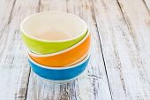pic of ceramic bowl  - Close up colorful ceramic bowl on the wooden background - JPG